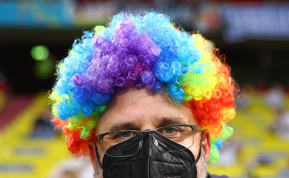 MUNICH, GERMANY - JUNE 23: A fan is seen with a rainbow wig prior to the UEFA Euro 2020 Championship Group F match between Germany and Hungary at Allianz Arena on June 23, 2021 in Munich, Germany. (Photo by Kai Pfaffenbach - Pool/Getty Images)
