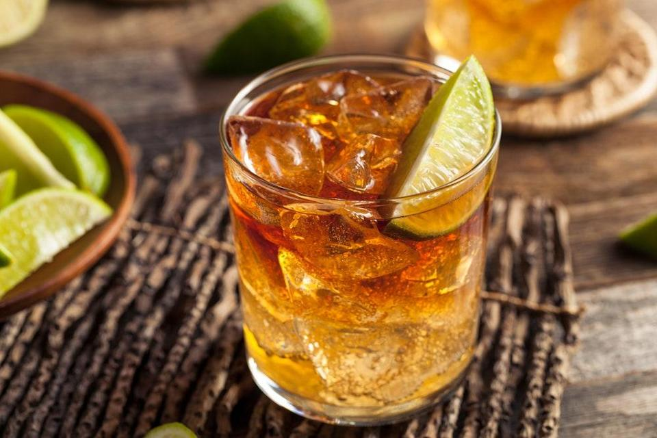 """Sweet dark rum and spicy ginger beer are perfect partners in this easy all-seasons rum drink recipe. <a href=""""https://www.epicurious.com/recipes/food/views/dark-and-stormy-235964?mbid=synd_yahoo_rss"""" rel=""""nofollow noopener"""" target=""""_blank"""" data-ylk=""""slk:See recipe."""" class=""""link rapid-noclick-resp"""">See recipe.</a>"""