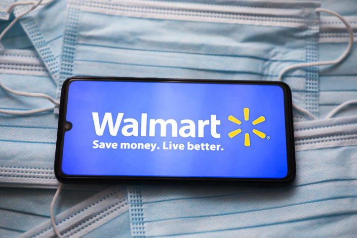 Walmart logo is displayed on a mobile phone screen photographed on surgical masks background for illustration photo during the coronavirus pandemic. Gliwice, Poland on April 21, 2021.  (Photo by Beata Zawrzel/NurPhoto via Getty Images)