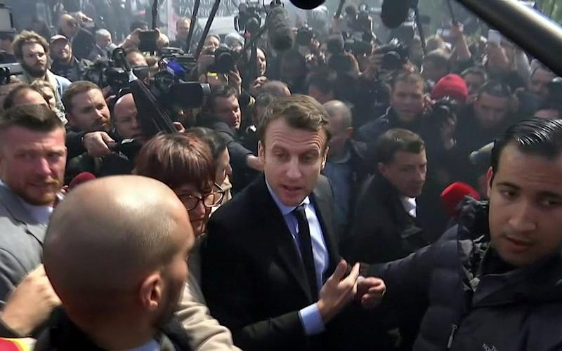 A still image taken from video shows Emmanuel Macron, head of the political movement En Marche !, or Onwards !, and candidate for the 2017 French presidential election, talking to Whirlpool employees in front of the company plant in Amiens - Credit:  REUTERS