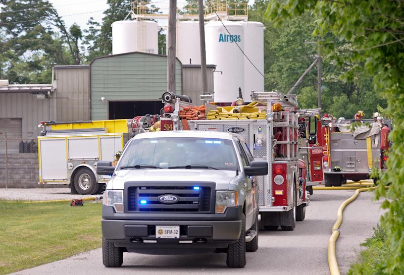 Putnam County officials respond to the scene where several acetylene cylinders exploded at the Airgas facility in Black Betsy, W.Va., Monday afternoon, May 13, 2013. Fire crews were dispatched at about 3:20 p.m. to Airgas, a distributor of specialty gases, said Jason Owens of Putnam County's emergency management center. He described the injuries to the two as minor and said they were transported to Cabell Huntington Hospital for treatment. A hospital official did not know their conditions. (AP Photo/Daily Mail, Bob Wojcieszak)