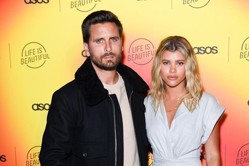 A rare photo of Scott Disick in casual jacket and denim pant, beside his girlfriend, Sofia Richie, who is dressed in a lovely white jumpsuit.