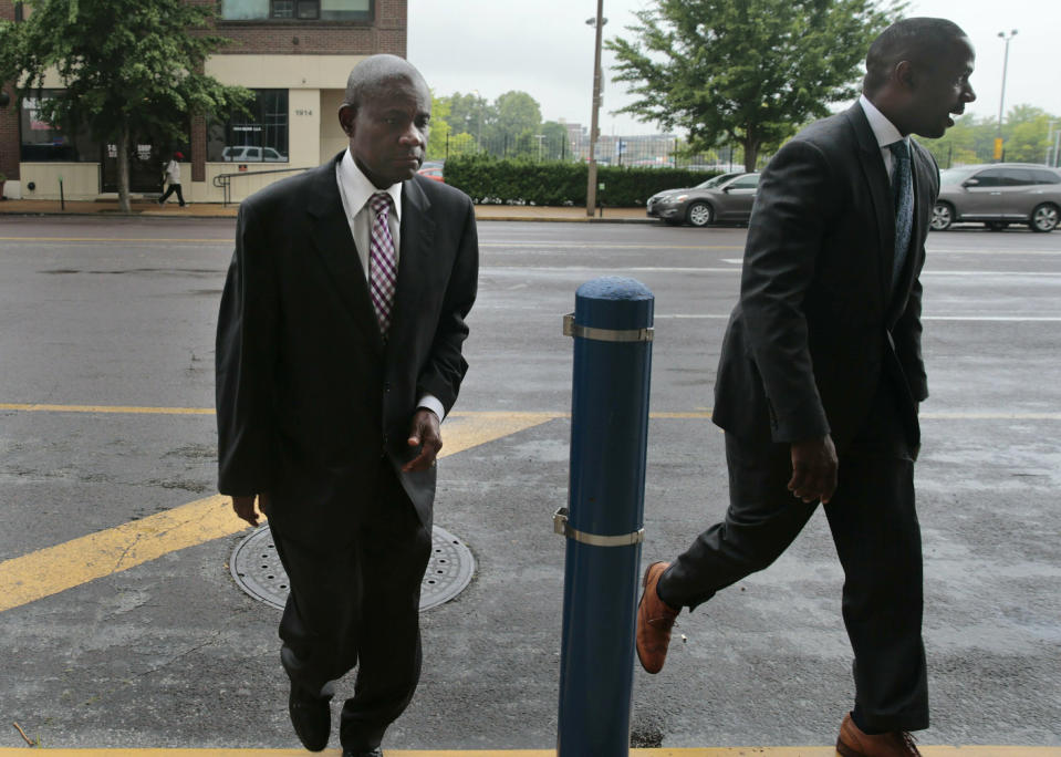 FILE - In this June 17, 2019 file photo, former FBI agent William Don Tisaby, left, is accompanied by attorney Jermaine Wooten, in St Louis. A St. Louis judge said Thursday, June 24, 2021, that he'll decide by the end of next week whether to allow the special prosecutor to withdraw from the perjury and evidence tampering case against Tisaby, a former FBI agent hired by St. Louis' top prosecutor to investigate former Gov. Eric Greitens. Tisaby, 68, was indicted in 2019. (Robert Cohen/St. Louis Post-Dispatch via AP, File)