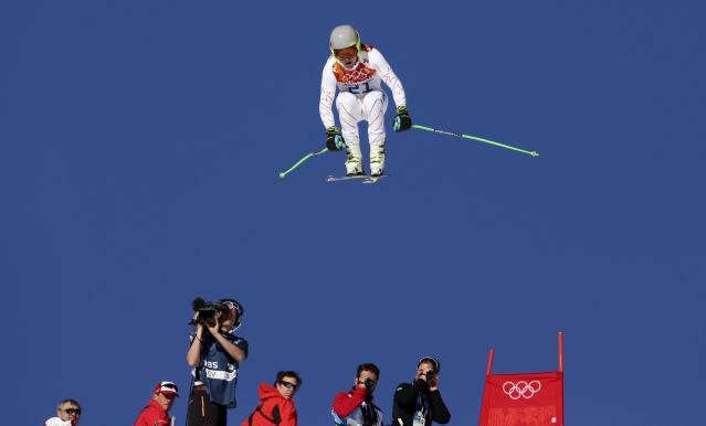 Ted Ligety of the U.S. takes a jump during the downhill run of the men's alpine skiing super combined training session at the 2014 Sochi Winter Olympics at the Rosa Khutor Alpine Center February 13, 2014. REUTERS/Stefano Rellandini (RUSSIA - Tags: SPORT SKIING OLYMPICS)