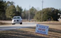 <p>A vehicle drives past a polling place during the U.S. Democratic presidential primary in Kershaw, S.C., on Saturday. <i>(Photo: Chris Keane/Reuters)</i></p>