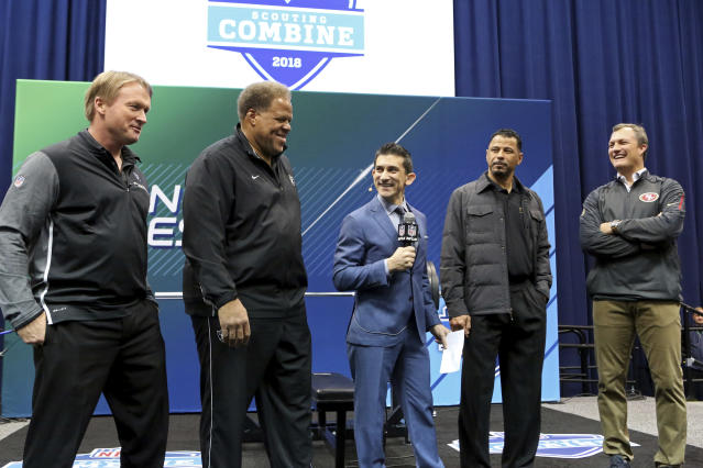 From left, Oakland Raiders head coach Jon Gruden, GM Reggie McKenzie, NFL Network host Andrew Siciliano, Hall of Famer Rod Woodson and San Francisco 49ers GM John Lynch ar seen at the official coin flip to determine the 9th and 10th picks for the 2018 NFL Draft on Friday. (AP)