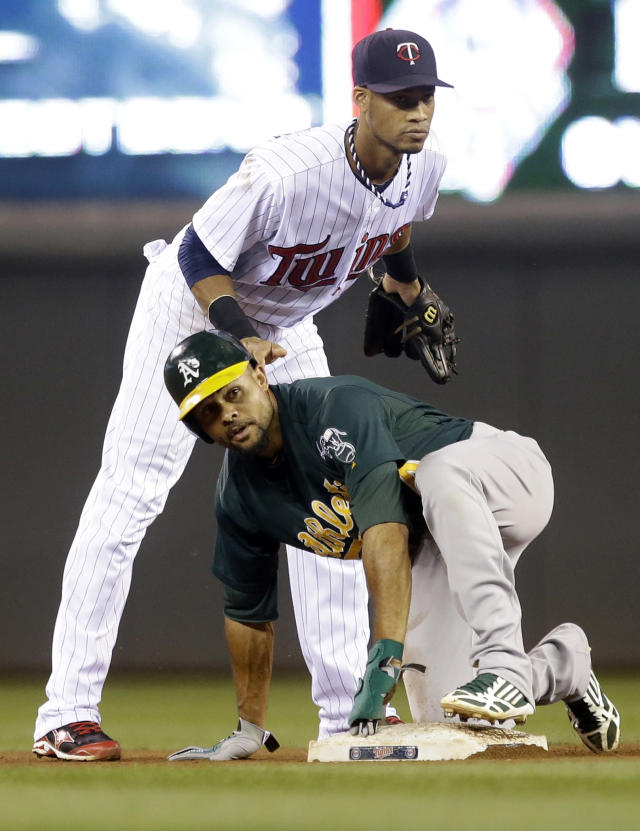 Oakland Athletics' Coco Crisp, right, steals second with no play by Minnesota Twins shortstop Pedro Florimon in the fourth inning of a baseball game, Tuesday, Sept. 10, 2013, in Minneapolis. (AP Photo/Jim Mone)
