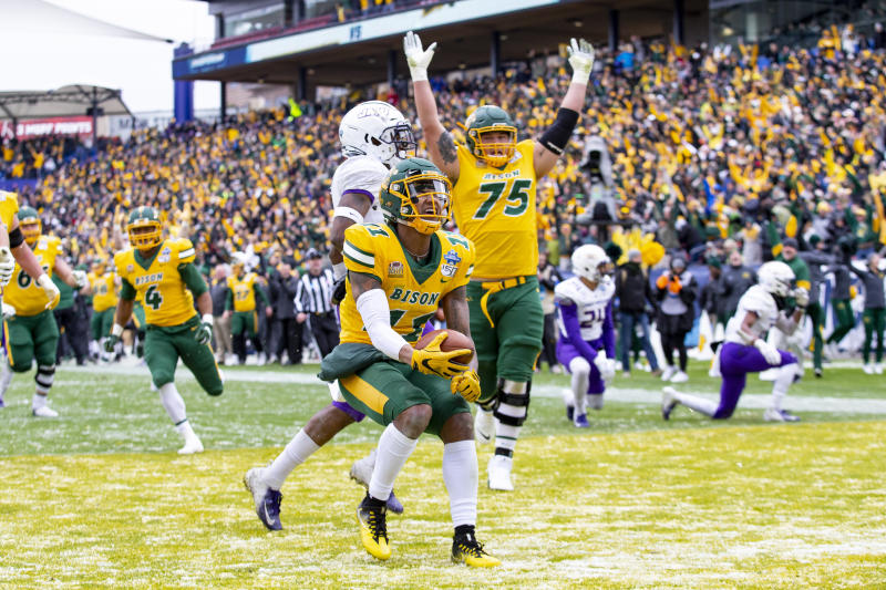 North Dakota State wide receiver Phoenix Sproles (11) smiles after scoring a touchdown during the first half of the FCS championship NCAA college football game against James Madison, Saturday, Jan. 11, 2020, in Frisco, Texas. (AP Photo/Sam Hodde)