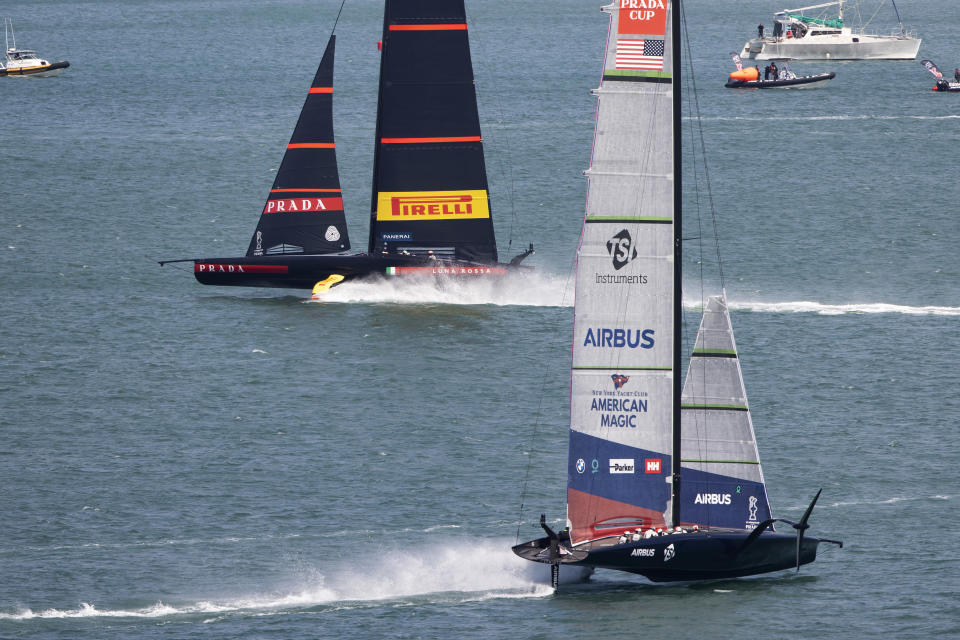 Italy's Luna Rossa, left, leads American Magic during the America's Cup challenger series on Auckland's Waitemate Harbour, New Zealand, Friday, Jan. 29, 2021. High winds and harsh reality blew away American Magic's hope of a fairytale return to the America's Cup challenger series when Italy's Luna Rossa won both races on the first day of the best-of-seven semifinals. (Brett Phibbs/NZ Herald via AP)