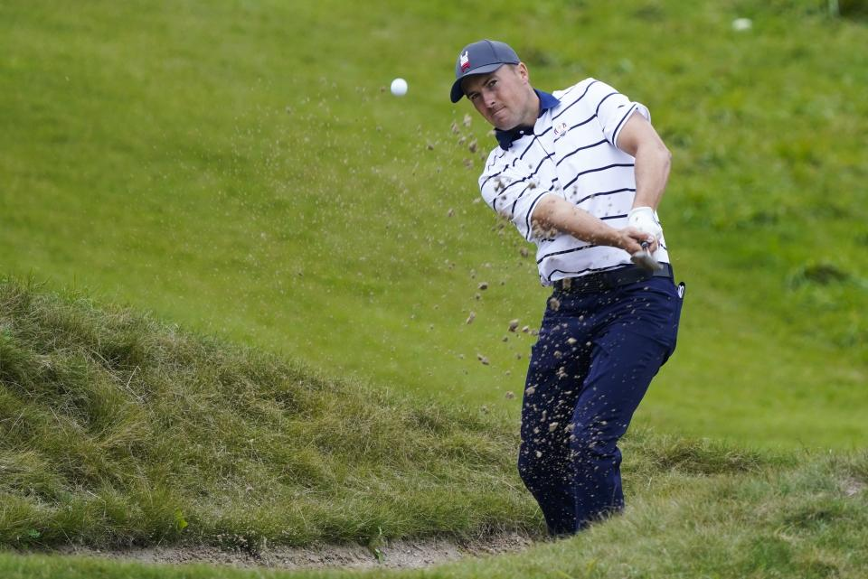 Team USA's Jordan Spieth hits from a bunker on the first hole during a practice day at the Ryder Cup at the Whistling Straits Golf Course Tuesday, Sept. 21, 2021, in Sheboygan, Wis. (AP Photo/Charlie Neibergall)