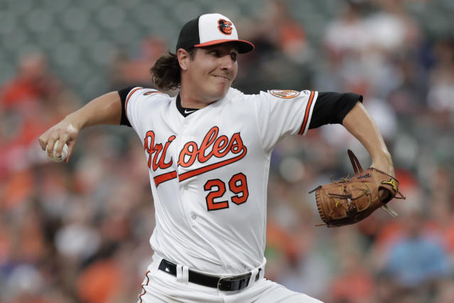 Baltimore Orioles starting pitcher Asher Wojciechowski throws to a Washington Nationals batter during the second inning of a baseball game, Tuesday, July 16, 2019, in Baltimore. (AP Photo/Julio Cortez)