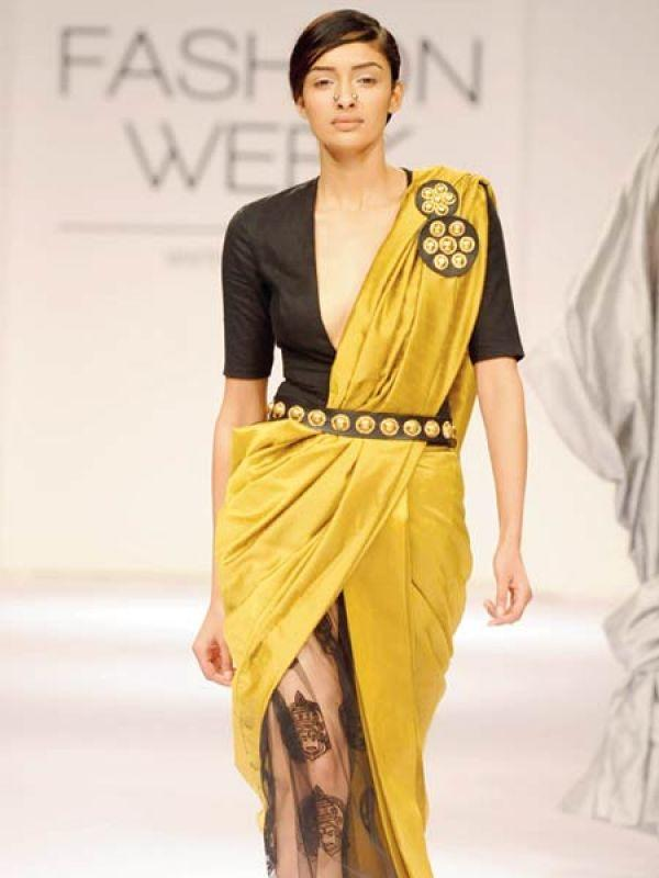 <p><strong>Image courtesy : iDiva.com</strong></p><p><strong>2. Sheer sari pleats<br /></strong>Inspired from: Nikhil Thampi's 2013 winter-festive collection<br />This is a hybrid look for the brazen and body confident. Incorporate fashion's current favourite ┠sheer ┠into a half <em>sari </em>through net pleats.</p><p><strong>Related Articles - </strong></p><p><a href='http://idiva.com/photogallery-style-beauty/9-trendy-looks-for-9-nights-of-navratri-lust-list/24777' target='_blank'>9 Trendy Looks for 9 Nights of Navratri [Lust List]</a></p><p><a href='http://idiva.com/photogallery-style-beauty/hot-fusion-ensembles-for-the-festive-season/7360' target='_blank'>Hot Fusion Ensembles for the Festive Season</a></p>