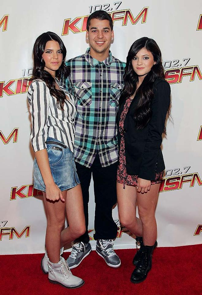 "Rob Kardashian took his little sisters Kendall, 14, and Kylie, 12, to the sold-out concert. Think they're wearing age-appropriate attire? Noel Vasquez/<a href=""http://www.wireimage.com"" target=""new"">WireImage.com</a> - May 15, 2010"