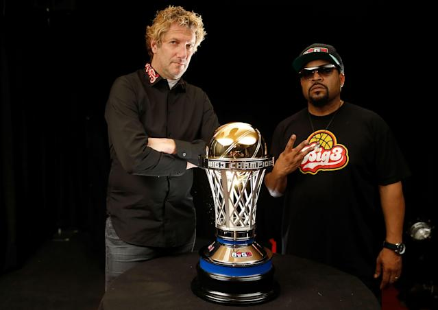Big3 cofounders Jeff Kwatinetz and Ice Cube pose with the league's championship trophy this past August. (Getty Images)