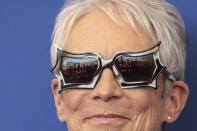 FILE - In this Sept, 8, 2021 file photo Jamie Lee Curtis poses for photographers, reflected in glasses, at the photo call for the film 'Halloween Kills' during the 78th edition of the Venice Film Festival in Venice, Italy. (Photo by Joel C Ryan/Invision/AP, File)