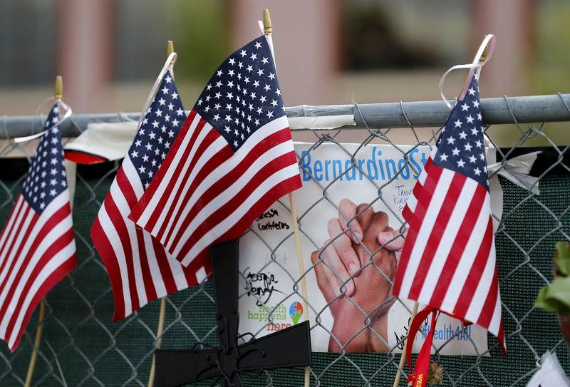 FILE PHOTO: File photo of a memorial outside the Inland Regional Center (IRC) where 14 people were massacred last month by a married couple inspired by Islamist militants in San Bernardino, California, January 4, 2016. REUTERS/Mike Blake/File Photo