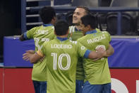 Seattle Sounders' Jordan Morris, back right, celebrates with teammates after he scored his first goal of the first half of the team's MLS soccer match against the San Jose Earthquakes, Thursday, Sept. 10, 2020, in Seattle. (AP Photo/Ted S. Warren)