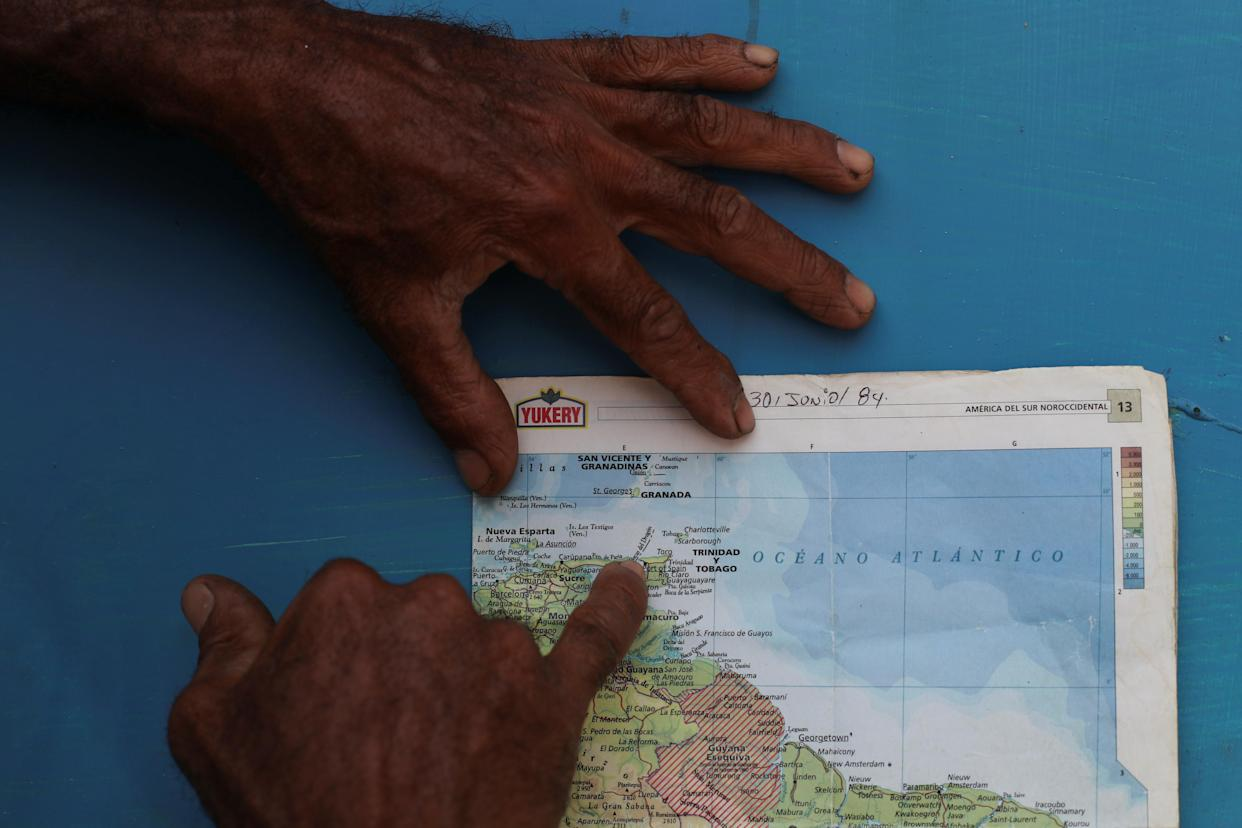 A local resident points at an area nicknamed the Dragon's Mouths, where Maroly Bastardo disappeared in the Caribbean Sea, in Guiria, Venezuela, on May 23. (Photo: Ivan Alvarado/Reuters)