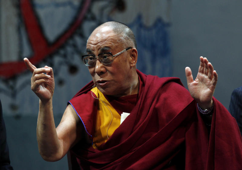 Tibetan Buddhist spiritual leader the Dalai Lama, gestures as he sits on a panel at the Newark Peace Education Summit early Friday, May 13, 2011, in Newark, N.J. The three-day summit on the power of nonviolence will include Nobel laureates, international leaders, local anti-violence activists and the Dalai Lama. (AP Photo/Mel Evans)