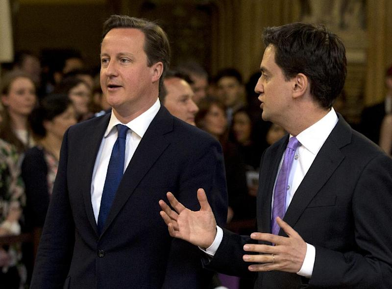 Britain's Prime Minister David Cameron, left, with the Leader of the Opposition Ed Milliband walk from the House of Commons through the central lobby towards the House of Lords to hear Britain's Queen Elizabeth II deliver the Queen's Speech to Parliament at the Place of Westminster in London Wednesday, May 8, 2013. The Queen's Speech outlines her governments legislative plans for the forthcoming parliamentary year, that her lawmakers will debate vote and enact on.(AP Photo/Alastair Grant, Pool)