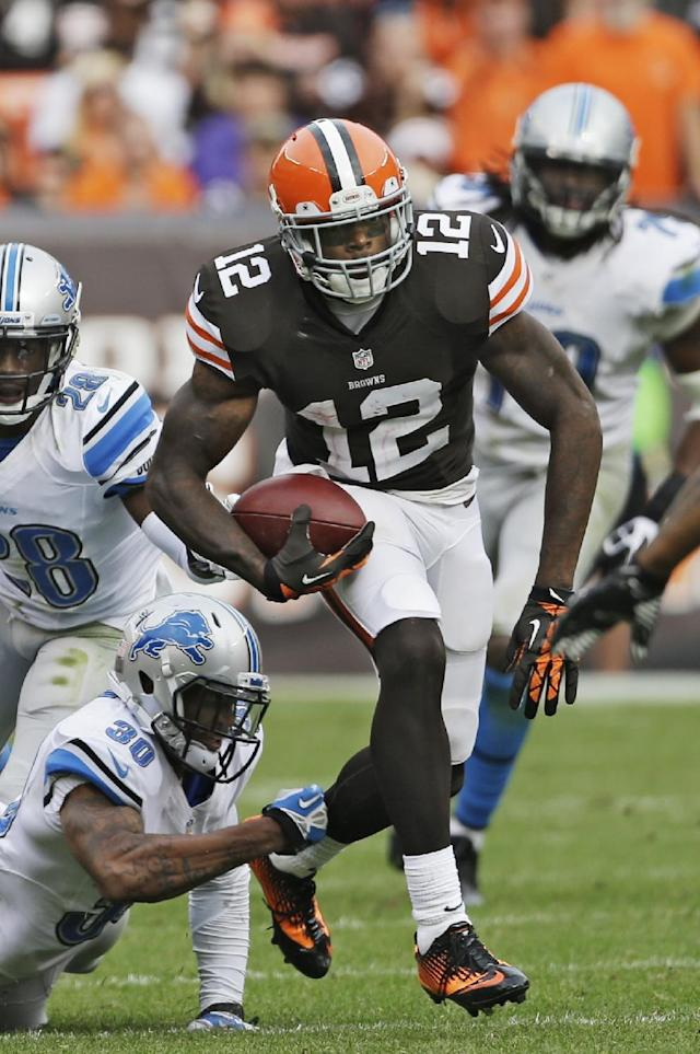FILE - In this Sunday, Oct. 13, 2013, file photo, Cleveland Browns wide receiver Josh Gordon (12) breaks away from Detroit Lions defensive back Darius Slay (30) after a reception in the fourth quarter of an NFL football game in Cleveland. Gordon is tired of the trade rumors that have been whipping around him for weeks. With Tuesday's deadline approaching, Gordon could be down to his final days in Cleveland, where the front office insists it has not been shopping him to other teams. (AP Photo/Mark Duncan, File)