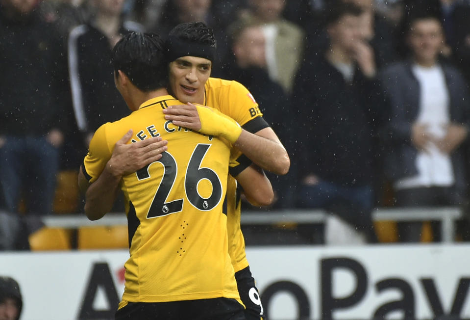 Wolverhampton Wanderers' Hwang Hee-chan celebrates with teammate Wolverhampton Wanderers' Raul Jimenez after scoring his side's opening goal during the English Premier League soccer match between Wolverhampton Wanderers and Newcastle United at Molineux stadium in Wolverhampton, England, Saturday, Oct. 2, 2021. (AP Photo/Rui Vieira)