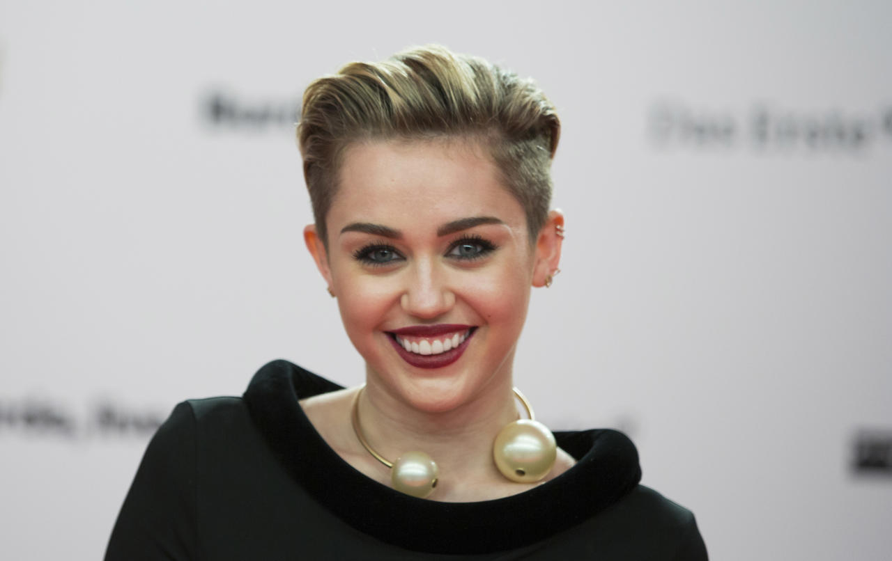 In this Thursday, Nov. 14, 2013 photo, singer Miley Cyrus arrives for the Bambi 2013 media awards in Berlin, Germany. MTV is celebrating Cyrus' 21st birthday with eight hours of programming hosted by her on Saturday, Nov. 23, 2013. (AP Photo/Gero Breloer, File)