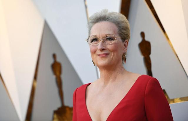 <p>Meryl Streep wears chic glasses with her Dior red gown at the 2018 Oscars red carpet. (Photo: Getty Images) </p>