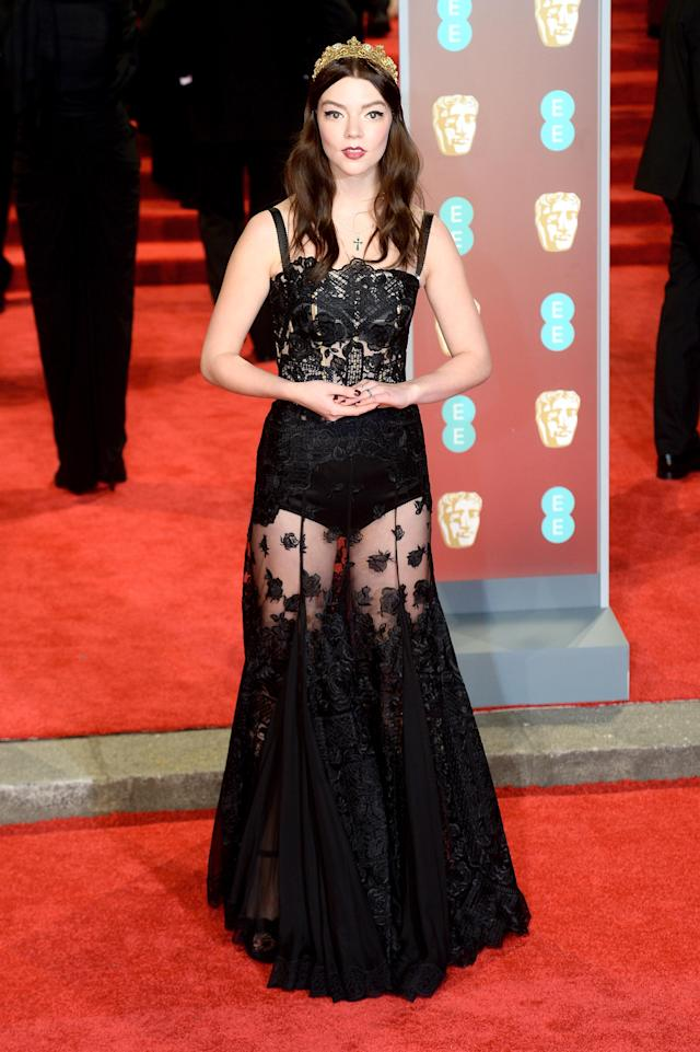 "<p>""The Miniaturist"" actress paired a headpiece with a lace gown by Dolce & Gabbana. </p>"