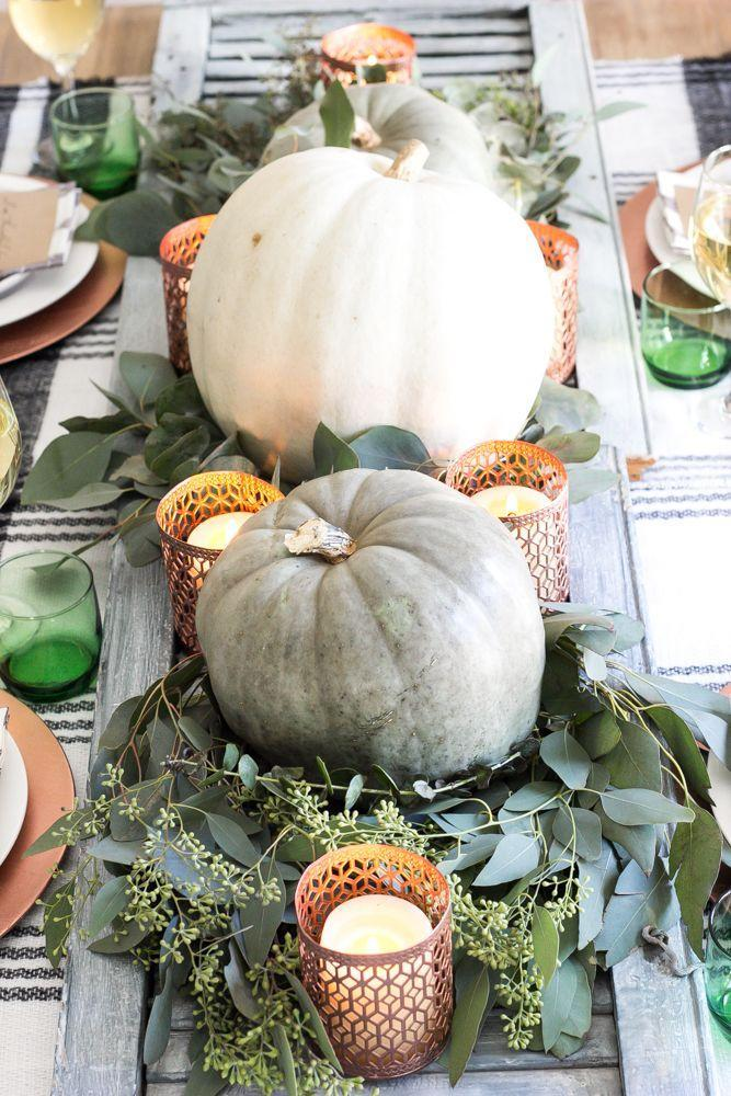 "<p>Bring in a touch of glam by adding copper votive candle holders to this green and white pumpkin medley. </p><p><a class=""link rapid-noclick-resp"" href=""https://www.amazon.com/Just-Artifacts-Mercury-Holders-Speckled/dp/B01LWOLFVY/?tag=syn-yahoo-20&ascsubtag=%5Bartid%7C10055.g.1681%5Bsrc%7Cyahoo-us"" rel=""nofollow noopener"" target=""_blank"" data-ylk=""slk:SHOP COPPER VOTIVE HOLDERS"">SHOP COPPER VOTIVE HOLDERS</a></p><p><em><a href=""https://www.blesserhouse.com/green-and-copper-thanksgiving-tablescape-printable/?"" rel=""nofollow noopener"" target=""_blank"" data-ylk=""slk:Get the tutorial at Blesser House »"" class=""link rapid-noclick-resp"">Get the tutorial at Blesser House »</a></em></p>"