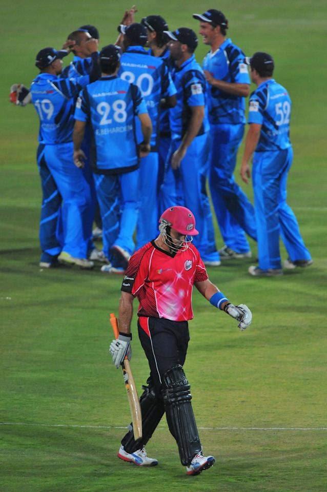 PRETORIA, SOUTH AFRICA - OCTOBER 26: (SOUTH AFRICA OUT) Michael Lumb of the Sixers walks off after being dismissed for 33 runs during the Karbonn Smart CLT20 Semi Final match between Nashua Titans and Sydney Sixers at SuperSport Park on October 26, 2012 in Pretoria, South Africa (Photo by Duif du Toit/Gallo Images/Getty Images)