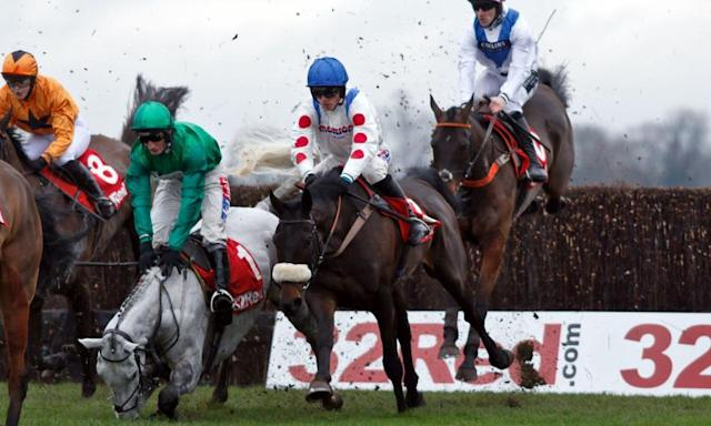 <span>Waiting Patiently, in the air at the King George's ninth fence, is about to be brought to a standstill by the grey Bristol De Mai falling and then rolling in front of him. </span> <span>Photograph: Steve Cargill/racingfotos/Rex/Shutterstock</span>