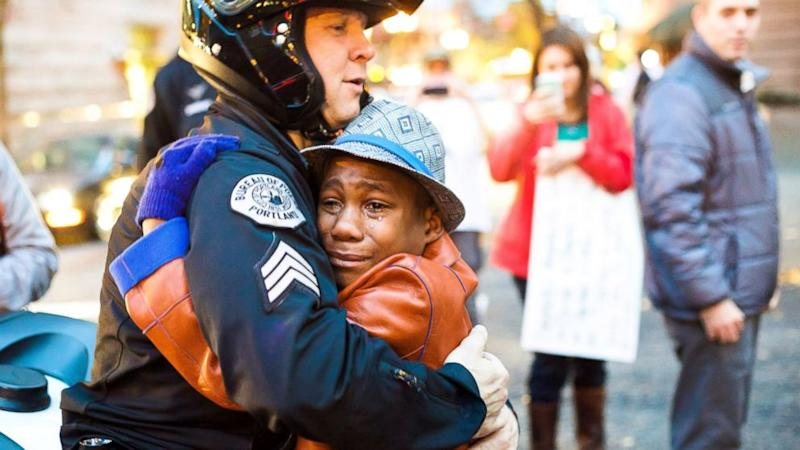 Photo of Cop Hugging Boy at Ferguson Protest Tells Poignant Story