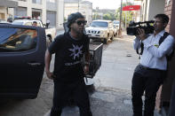 Former Brazilian soccer star Ronaldinho, or Ronaldo de Assis Moreira, arrives at Paraguay's attorney offices in Asuncion, Paraguay, Thursday, March 5, 2020. According to local news, Ronaldinho is accused of arriving in the country with a fake Paraguay passport. (AP Photo/Jorge Saenz)