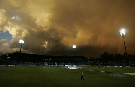 Clouds are seen as rain disrupts play during the IPL T20 cricket tournament between the Chennai Super Kings and the Kings Punjab in Centurion