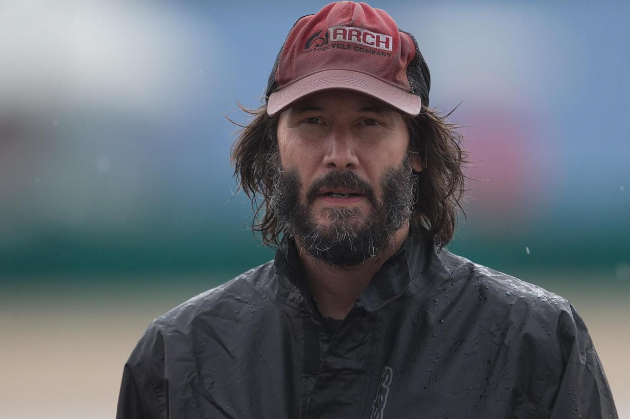 Keanu Reeves made the most of a travel snafu over the weekend —and also made some new friends. (Photo: Getty Images)