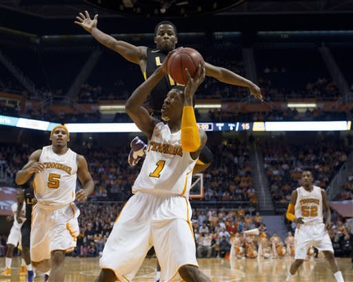 Tennessee's Josh Richardson attempts to score as LSU's Andre Stringer defends during the first half of an NCAA college basketball game Tuesday, Feb. 19, 2013, in Knoxville, Tenn. (AP Photo/The Knoxville News Sentinel, Saul Young)