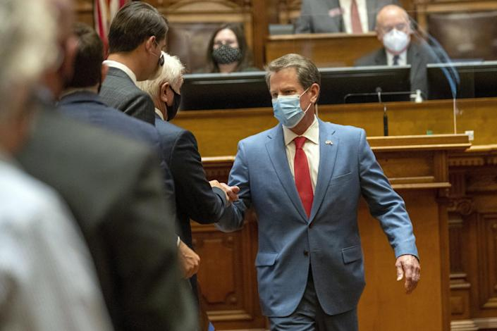 Georgia Gov. Brian Kemp is greeted as he visits the House Chambers on Sine Die, day 40, of the legislative session in Atlanta, Friday, June 26, 2020.