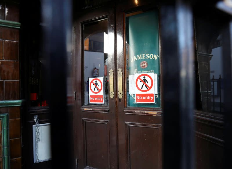 Pub doors are locked in the Temple Bar area, as bars across Ireland are to close voluntarily to curb the spread of coronavirus in Dublin