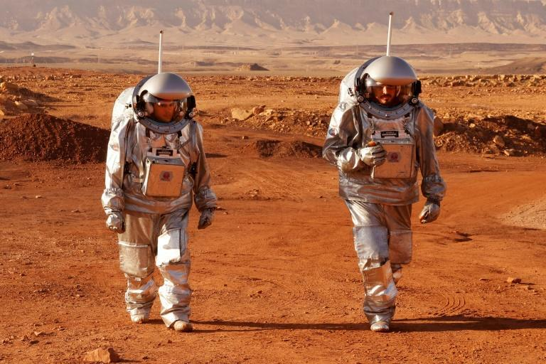 A couple of trainee astronauts walk in their spacesuits during a training mission for planet Mars inside the Ramon Crater in Mitzpe Ramon in Israel's southern Negev desert (AFP/JACK GUEZ)