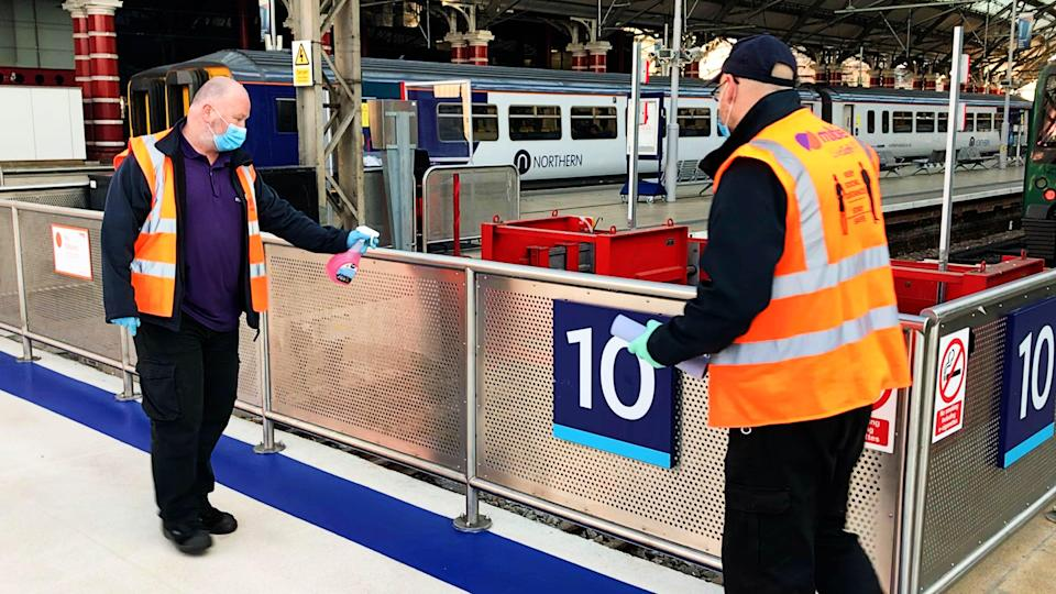 Handrails being cleaned at Liverpool Lime Street station (Network Rail/PA) (PA Media)