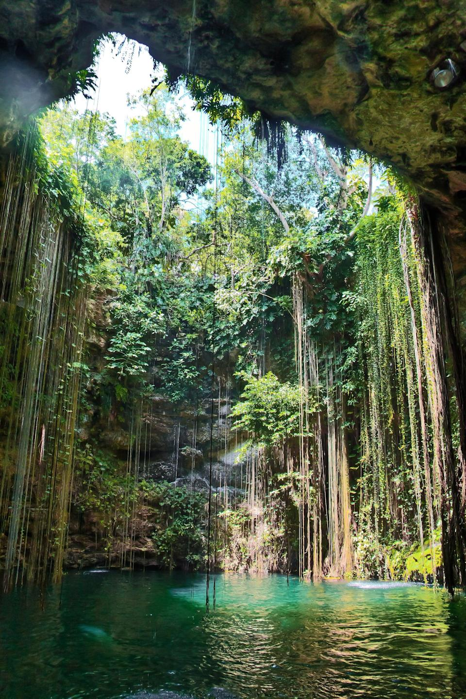 <p>A cenote is a natural sinkhole that fills up with water - many people in past civilizations would use it as a natural well for water. Ik Kil is one of the more famous cenotes in Mexico and is well worth a visit. </p>