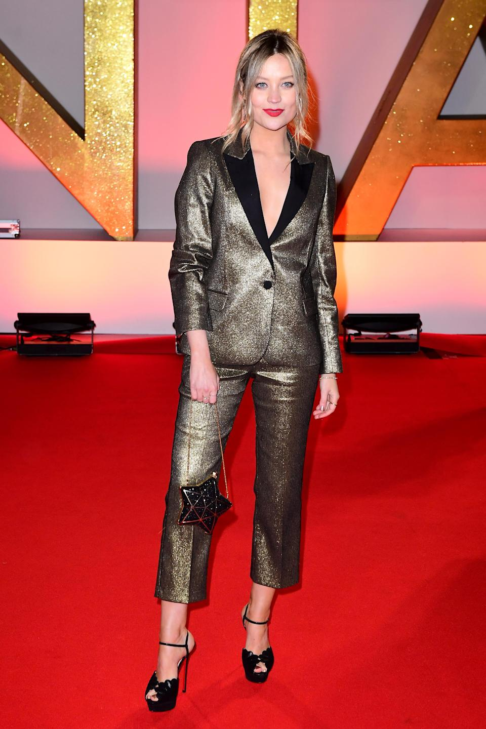 <p>Wearing Zadig & Voltaire accessorised with Louboutin platforms and an Aspinal of London bag. <em>[Photo: Getty]</em> </p>