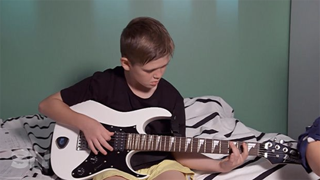 Cameron loves to play guitar, and finds that it helps his Tourette's.