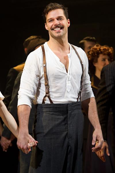 """FILE - In this March 12, 2012 file photo, Ricky Martin appears at the curtain call after his first performance in the new Broadway production of """"Evita"""", in New York. (AP Photo/Charles Sykes, file)"""