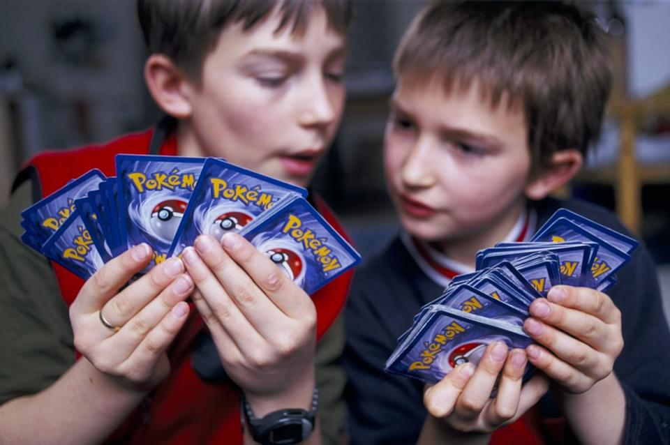 children playing with pokemon cards
