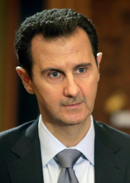 Syrian President Bashar al-Assad, shown in a file picture taken on January 18, 2014, said Damascus is negotiating with ally Moscow to purchase the latest anti-missile system