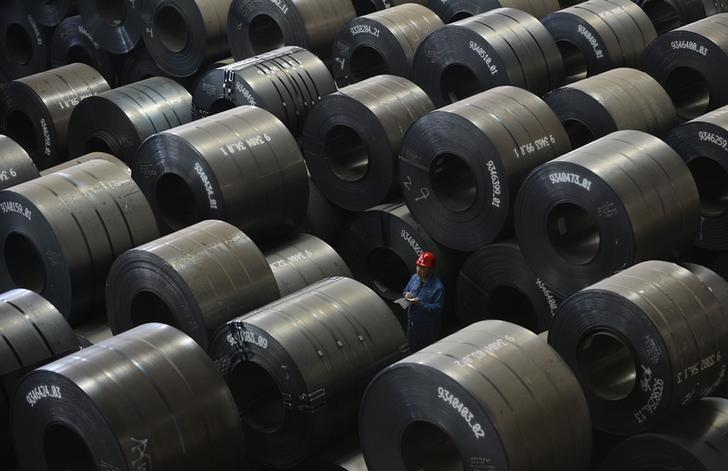 An employee works inside a steel export factory in Taiyuan