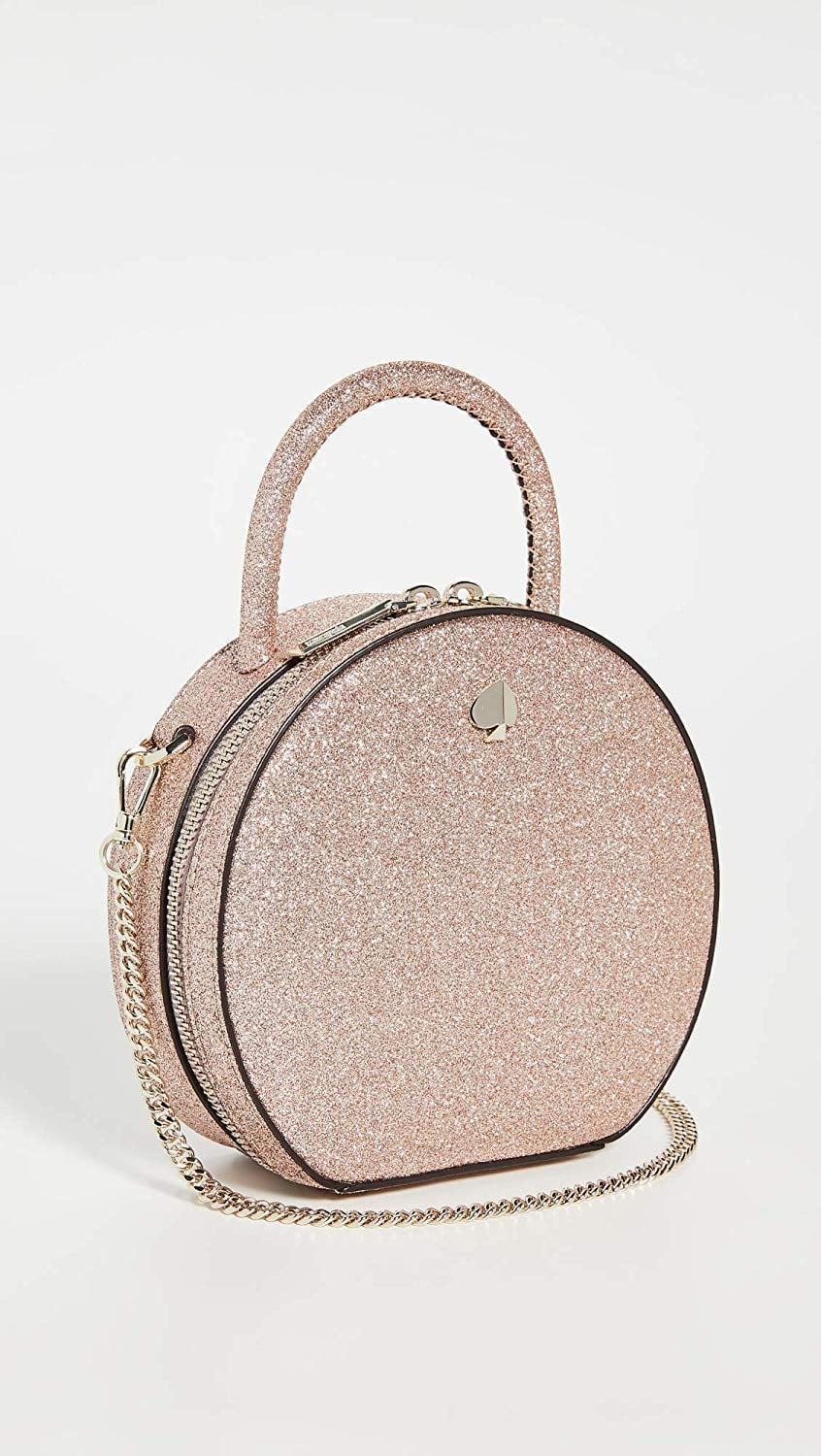 """<p>This sparkly <a href=""""https://www.popsugar.com/buy/Kate-Spade-New-York-Andi-Glitter-Mini-Canteen-Bag-523504?p_name=Kate%20Spade%20New%20York%20Andi%20Glitter%20Mini%20Canteen%20Bag&retailer=amazon.com&pid=523504&price=258&evar1=fab%3Auk&evar9=46947746&evar98=https%3A%2F%2Fwww.popsugar.com%2Ffashion%2Fphoto-gallery%2F46947746%2Fimage%2F46949307%2FKate-Spade-New-York-Andi-Glitter-Mini-Canteen-Bag&list1=shopping%2Camazon%2Choliday%2Choliday%20fashion%2Cfashion%20shopping&prop13=api&pdata=1"""" rel=""""nofollow noopener"""" class=""""link rapid-noclick-resp"""" target=""""_blank"""" data-ylk=""""slk:Kate Spade New York Andi Glitter Mini Canteen Bag"""">Kate Spade New York Andi Glitter Mini Canteen Bag</a> ($258) is a dream come true.</p>"""