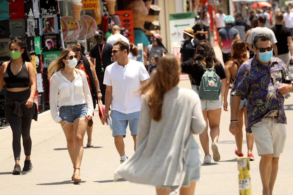 People walk along the Venice Beach Boardwalk in Los Angeles on July 5, the day after one email was written. Source: Getty